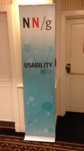 Nielsen Norman Group Usability Week banner in hallway