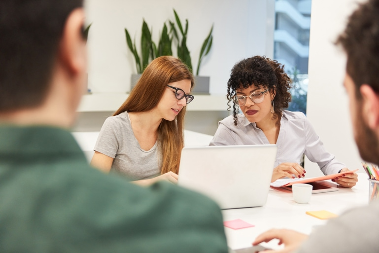 Two women reviewing an older website in regard to digital transformation