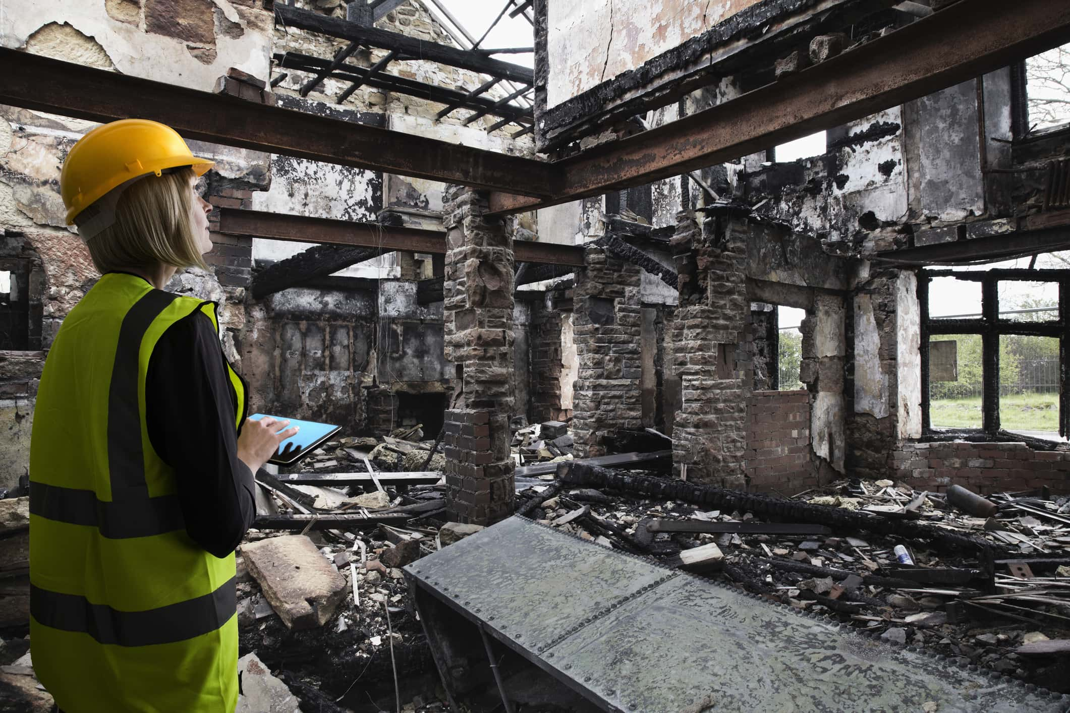 Woman assessing damage from a fire