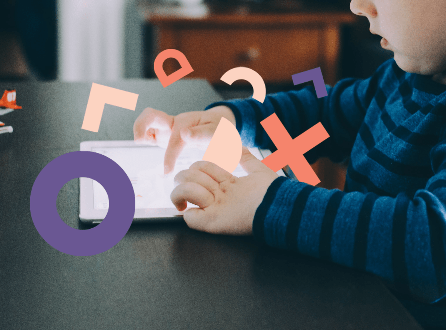 Hero image showing the hands of a toddler using a tablet with OXD brand letters